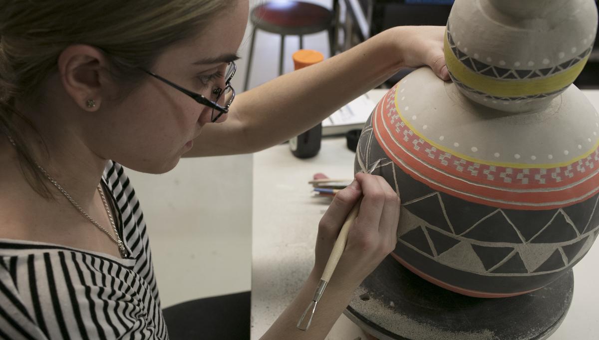 Ceramic student painting