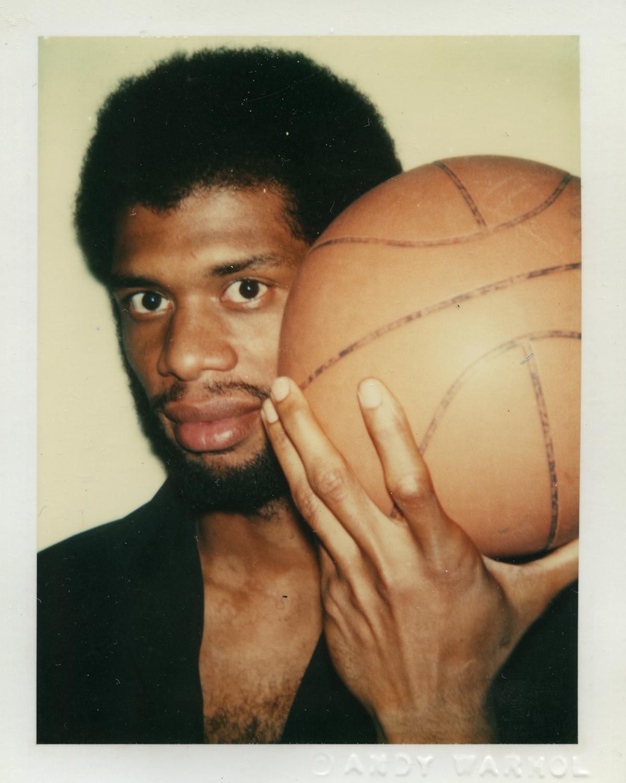 Polaroid of Kareem Abdul-Jabbar holding a basketball taken by Andy Warhol