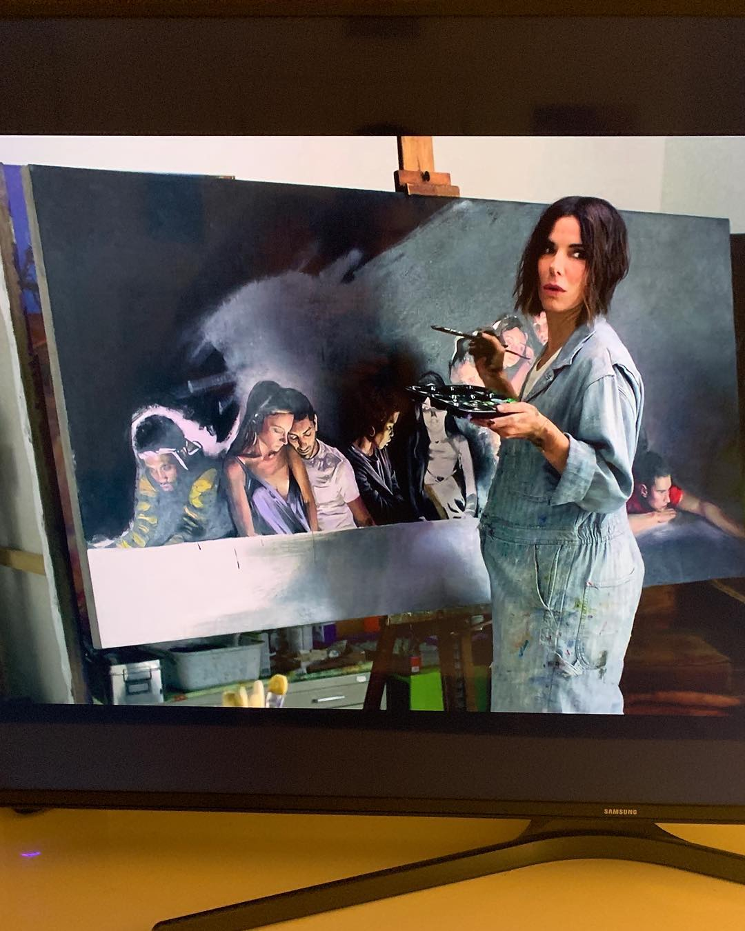 Sandra Bullock with work by alumna Lily Morris