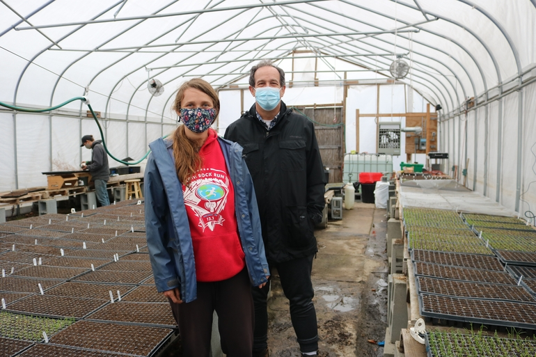 Farmer Tim's Vegetables Owner Tim Carroll and Farm Manager Katie Bekel in one of their greenhouses in Dudley