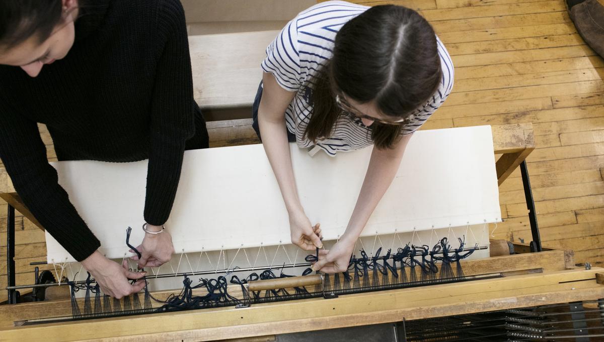 Fibers students at loom