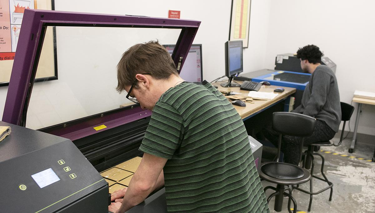 Students using laser cutter
