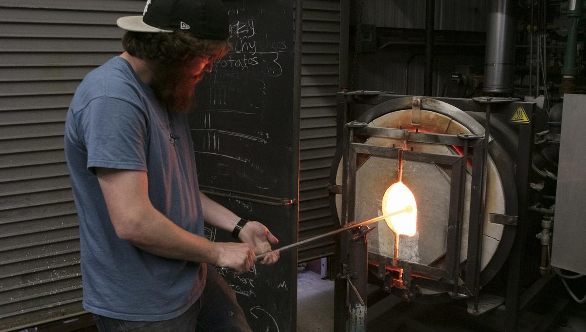Glass student in hotshop