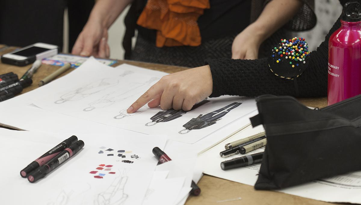 Student showing fashion designs