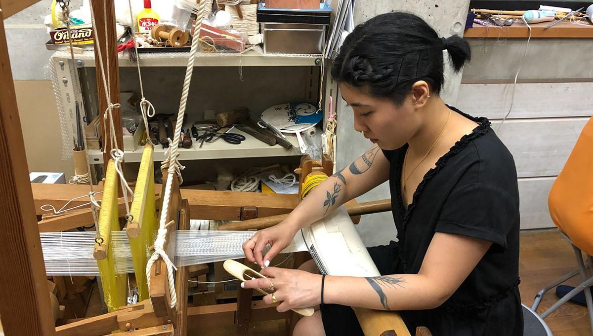 Student weaving in Japan