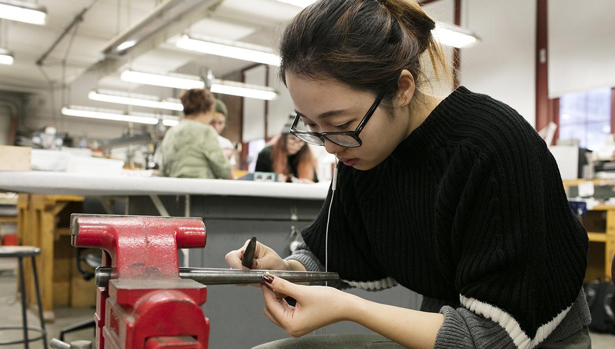 Student working in metalshop