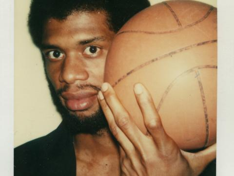 Polaroid of Kareem Abdul-Jabbar holding a basketball taken by Andy Warhol
