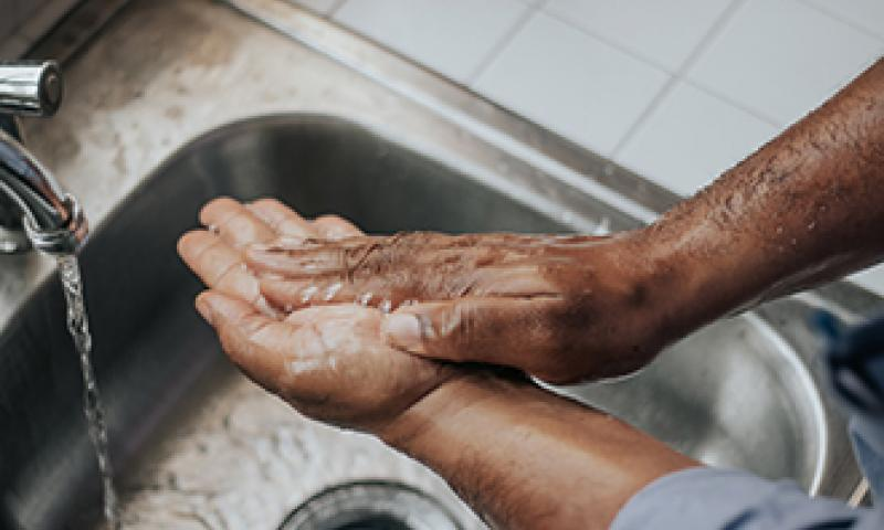 Hands washing by Melissa Jeanty via Unsplash