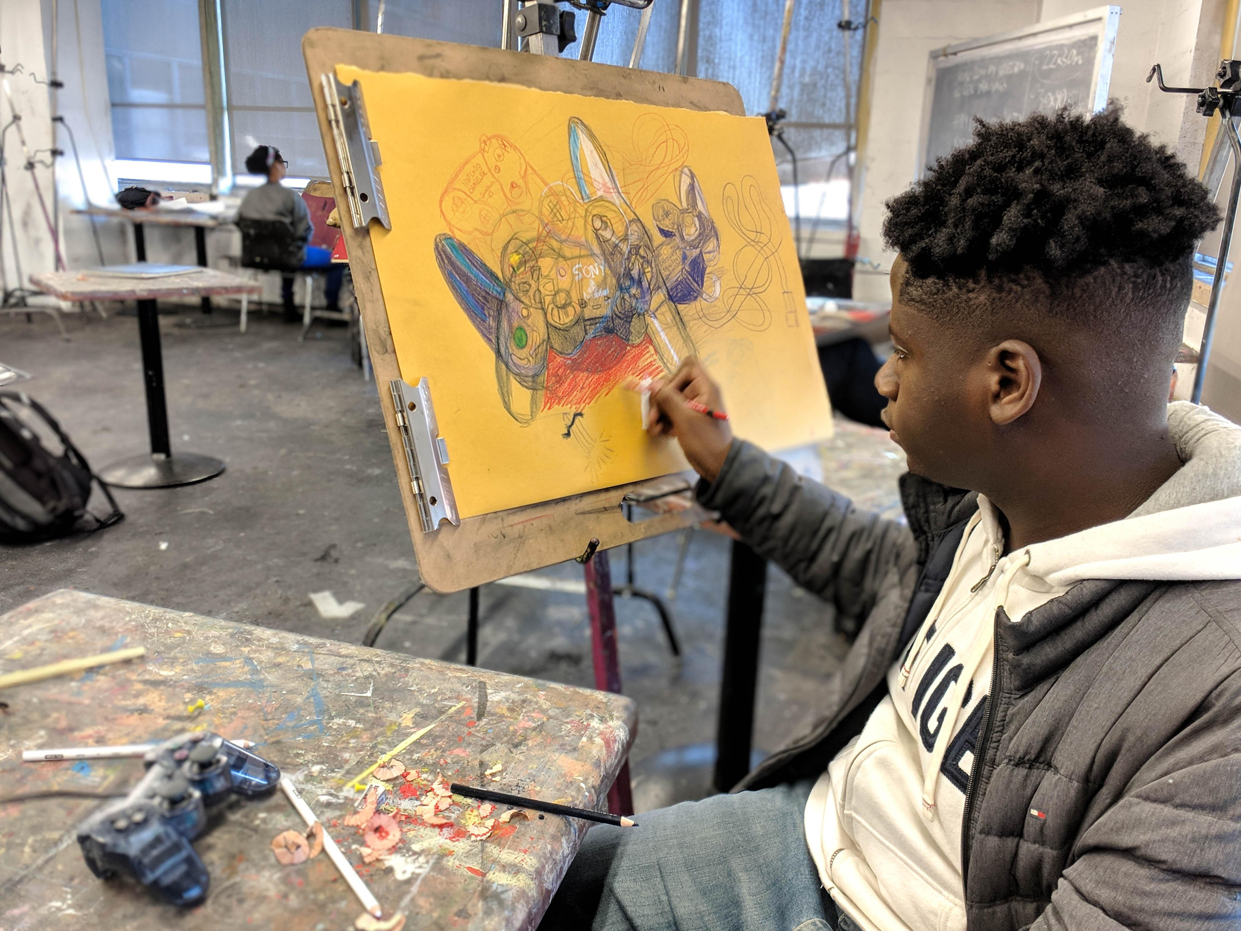 Artward Bound student working on a painting